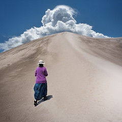 Tibetan woman (marianna_away for a while) Tags: blue sky woman usa cloud color up lady walking square sand colorado dunes tibetan mariannaarmata p2520323