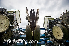 View from underneath farming tractor. (Remsberg Photos) Tags: blue usa tractor technology knoxville pennsylvania farm harvest gear equipment transportation ag agriculture advanced wormseyeview notill closingwheel