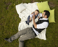 padre e figlio (Zioluc) Tags: man green grass child father lawn son blanket cushion lay luciobeltrami