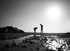 Beach. (Stefano-Bosso) Tags: sea people blackandwhite italy sun black beach monochrome silhouette rock mono rocks waves liguria ste blakwhite blackwhitephotos stefanobosso