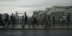 Crossing the Thames during rush hour, London (Dan_DC) Tags: people london towerbridge londonbridge walking symbol cloudy unitedkingdom sidewalk busy rainy rushhour thamesriver commuters symbolic londonbridgehospital symbolize