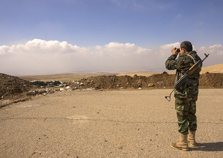 Kurdish Peshmerga Looking With Binoculars On The Frontline, Duhok, Kurdistan, Iraq