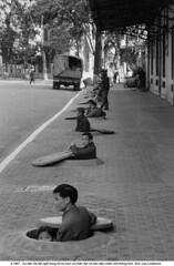 5569602 (ngao5) Tags: street during waiting politics cities vietnam sidewalk viet revolution manhole roads hanoi scenes defense siren alert civilian shelters residents cong timeincnotown 5569602