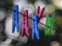 Clothesless pegs_c (gnarlydog) Tags: abstract closeup colorful bokeh pegs manualfocus soapbubbles clothespegs washingline projectionlens adaptedlens speckledhighlights