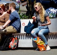 2 Apples . (Franc Le Blanc .) Tags: apple girl lumix sitting candid panasonic seated shertogenbosch iphone stationsplein streeteyewear