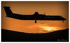 The Silhouette (D.k.o.w) Tags: sunset sky silhouette airplane belfast landing orangesky northernireland britishairways runway flybe georgebest belfastcityairport canon7dmkii