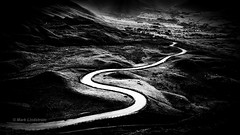 The Long and Winding Road (Mark Lindstrom) Tags: mamtor valeofedale derbyshire peakdistrict winding road outdoor landscape monochrome bw silverefexpro