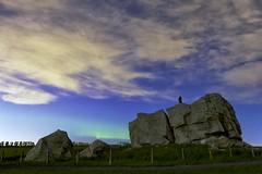 Michael Hill on the Big Rock (John Andersen (JPAndersen images)) Tags: grass night clouds fence stars farm alberta aurora geology bigrock glacial erratic okotoks
