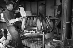 Flamed Salmon (Isengardt) Tags: flame flaming fire feuer salmon lachs fisch fish fishmarket market markt karlsplatz black white schwarz weiss bw sw monochrome monochrom essen food delikatesse stuttgart badenwrttemberg deutschland germany europe europa olympus omd em1 1250mm