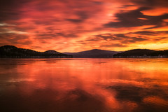 Lake Winnipesaukee - Fiery Sunrise (Robert Clifford) Tags: winter sky lake cold ice water clouds sunrise newengland newhampshire nh lakewinnipesaukee robertallanclifford robertallancliffordcom
