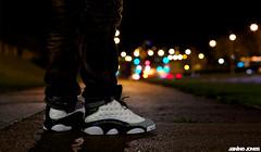 baron thirteens (thatgirlwiththekicks) Tags: night lights shoes bokeh air hologram sneakers nike retro jordan kicks iridescent 13 jumpman barons jordans xiii wolfgrey thirteens greytoe
