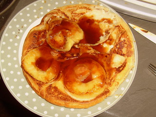 Pancake with apple and syrup