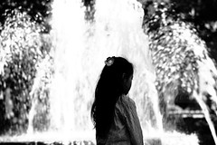 Joy (Elios.k) Tags: camera travel november vacation people blackandwhite bw flower travelling monument water fountain girl monochrome japan horizontal canon hair outdoors person photography japanese one back memorial asia long peace dof bokeh wwii jet young hiroshima depthoffield sanyo worldpeace atomicbomb upperbody abomb peacepark nuclearbomb sprinkle disarmament honshu hiroshimaprefecture 2015 backgroundblur chugoku memorialpeacepark chgoku 5dmkii sany focusinforeground