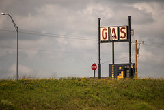 Gas (tommyr68) Tags: flowers oklahoma grass station nikon gas stop contemplative d60