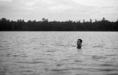 Swimming (yesimahuman) Tags: vacation lake film wisconsin 35mm cabin minolta kodak trix 400 filmphotography srt100 cabinporn