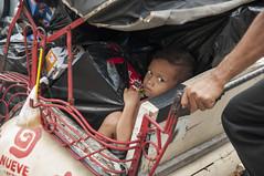Child portrait (Sibel Pipa - Photography) Tags: portrait indonesia asian asia child tricycle transport jogja heavy loads jogyakarta