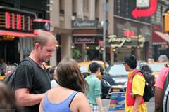 Faces of New York: loiters (Canadian Pacific) Tags: usa us unitedstates ofamerica america american city urban newyork manhattan people newyorker timessquare aimg6723 man woman lady men guy