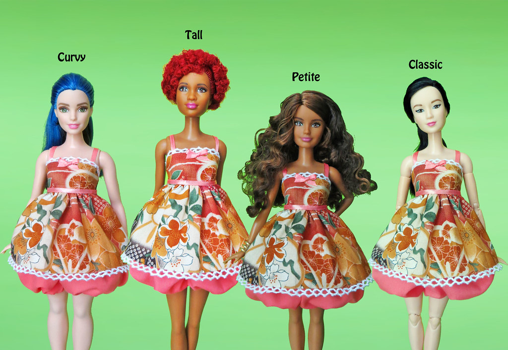 Compare and Contrast of Barbie Doll and Phenomenal Woman
