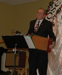 Tom Conaghan Playing a Tune on His Accordion