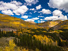 Million Dollar Autumn (RobertCross1 (off and on)) Tags: autumn trees mountains fall nature leaves clouds forest landscape colorado bluesky olympus aspens rockymountains omd sanjuanmountains em5 rockpaperexcellence 1250mmf3563mzuiko