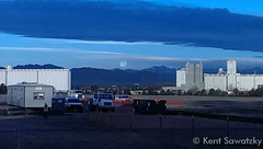 November 7, 2014 - The moon sets behind the Rockies as seen from north Denver. (Kent Sawatzky)