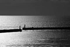 Safe anchorage (Keith in Exeter) Tags: sea blackandwhite seascape reflection monochrome silhouette landscape kent harbour anchorage stormysky dover englishchannel cruiseterminal harbourlights lamanche harbourwall harbourmouth westerndocks straitofdover diamondclassphotographer flickrdiamond absolutelystunningscapes admiraltypier southernbreakwater