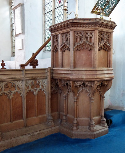 The (probably 19th C.) pulpit, cleverly blended into part of the dado of the 15th C. rood screen, the Church of St Peter and St Paul, Fressingfield, Suffolk, England