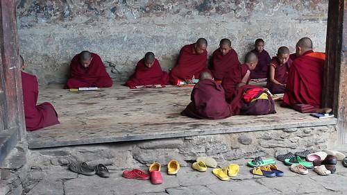 Around Jakar, Tamshing Lhakhang, young monks studying