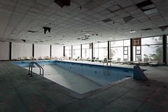 (Subversive Photography) Tags: usa newyork abandoned beautiful america canon hotel us deckchair decay atmosphere resort swimmingpool derelict canon5dmarkii danielbarter statesofdecay