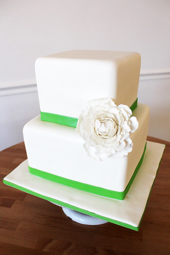 Square White Wedding Cake with Green Ribbon and Sugar Peony