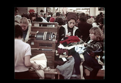 ss28-04 (ndpa / s. lundeen, archivist) Tags: city people color film boston store candid massachusetts nick citylife slide departmentstore slideshow mass 1970s shoppers dewolf filenes filenesbasement early1970s nickdewolf photographbynickdewolf slideshow28