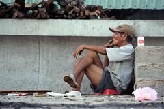 The man smoking at sea dyke (njeejul) Tags: sea man men beach beer long smoking vietnam viet dyke hai nam