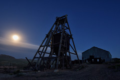 moonrise over the ohio mine. gold point, nv. 2016. (eyetwist) Tags: longexposure shadow sky building mill abandoned architecture night dark dead photography gold nikon ruins mine long exposure desert decay empty nevada ruin wideangle landmark mining fullmoon nv dirt american moonrise highdesert americana deathvalley lonely nikkor skip desolate derelict nocturne beatty shaft goldrush typology mojavedesert headframe goldpoint eyetwist npy 1024mm orebucket d7000 capturenx2 eyetwistkevinballuff 1024mmf3545g ohiomine americantypology