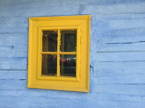 yellow window on the blue wall