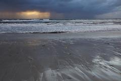 Light in the Dark (Stueyman) Tags: ocean sea sun storm beach rain clouds zeiss sony au indianocean australia wa 24mm alpha za westernaustralia a6000