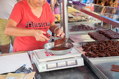 Woman cut and weigh Chinese dried pork at the street market (Evgeny Ermakov) Tags: street food woman asian cuisine town george asia southeastasia hand market body cut traditional chinese dry georgetown meat scissors pork exotic slice scales malaysia marketplace penang dried sliced southeast weigh bodypart jerky weighing streetmarket bak wetmarket kwa bakkwa rougan