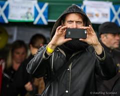 Shooting Me, Shooting You (FotoFling Scotland) Tags: camera scotland photographer event spectator balloch highlandgames iphone lochlomondhighlandgames