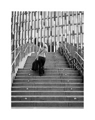 The city of a hundred spires XLVI (2 Marvelous 4 Words) Tags: windows bw woman building architecture stairs arquitectura prague overpass czechrepublic suitcase flyover goingup bestofficebuildingintheworldin2011 mipimawardscompetition