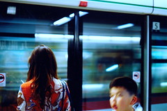 (toby.harvard) Tags: china hk blur film train 35mm canon subway photography hongkong 50mm slow metro ae1 candid 35mmfilm mysterious kowloon mtr filmphotography tobyharvard