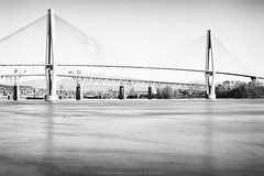 Across the Fraser (Wizard of Wonders) Tags: longexposure bridge blackandwhite lines vancouver boat bc britishcolumbia bridges railway quay wires fraserriver newwestminster ghostboat