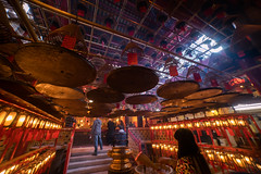 Sheung Wan Man Mo Temple  (KL.Lau  ) Tags: china travel red man history religious temple fire hongkong hope ancient worship shrine asia peace decorative buddha buddhist smoke sony faith religion pray chinese culture belief style buddhism fortune east altar hong kong burn luck smell offering stick wish oriental coil orient success a7 taoist incense scent taoism wealth prosperity faithful manmotemple worshiping