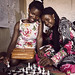 Florence and Diana play chess ikaaya girls' club in northern Kampala