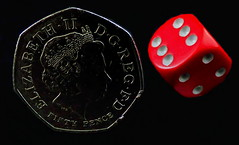 Smaller than a coin. (Les Fisher) Tags: dice coin onblack 50p macromondays smallerthanacoin