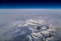 Alps and clouds from above (gc232) Tags: from sky cloud snow mountains alps window clouds alpes work canon dark landscape fly flying view angle live space altitude seat aviation flight wide cockpit aerial deck airline 24 24mm alpi pilot height iss 6d drone 24105l golfcharlie232