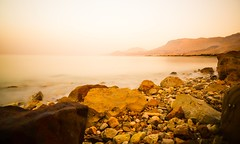 Touching The Water (Hazem Hafez) Tags: sunset beach bay rocks redsea shore ainsokhna l8ngexposure