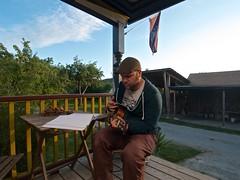 Strumming (Whistler Whatever) Tags: sunset summer musician music playing artist ukulele earth flag porch orcasisland tokinaatx116prodxaf1116mmf28 goldentreehostel