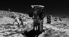 what they do to old cars in goldfield... (BillsExplorations) Tags: blackandwhite cars abandoned monochrome museum forest graffiti rust automobile decay nevada junkyard goldfield hss sliderssunday internationalcarforestofthelastchurch