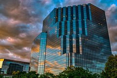 Sundown Reflections (Doug Wallick) Tags: park sunset lake reflection building clouds office suburban normandale bloomingtonminnesota skycloudy