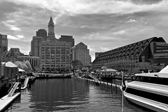 Arriving at Long Wharf (oxfordblues84) Tags: cruise sky blackandwhite bw reflection building brick water boston skyline architecture clouds buildings reflections hotel harbor boat harborcruise cloudysky customhouse longwharf bostonmassachusetts bostonharborcruise bostonmarriottlongwharf fredricklnolanjr marriottvacationclubpulseatcustomhouse