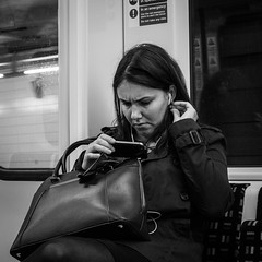 Tube Faces (evans.photo) Tags: people tube londonunderground candid trains frown phones travel